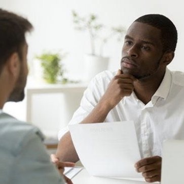 Leader engaged in thoughtful conversation