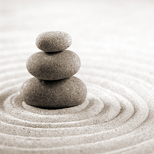 Leading from Within: Being Your Best Self Article Image - Balanced Rocks in Center of Sand Rings